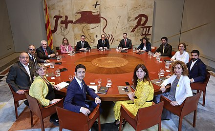 Government of Catalonia (2018-). Quim Torra, President of the Generalitat, is in the background, at the center; Pere Aragones, the Vice-president, on his right from his point of view Govern de Catalunya primera reunio 2018.jpg