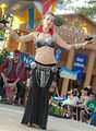 Graceful dancer heating up the audience (8211425564).jpg