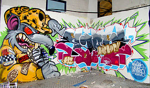 Hip hop - Hip hop-style graffiti showing stylized, elaborate lettering and colourful cartoons.