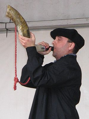 Blowing horn - Blowing an ox horn in a Basque festival