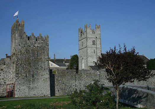 Fethard's village walls with mural tower house (at left) and church tower (at right).