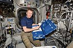 ISS-47 Tim Peake unpacks an analyzer in the Columbus module.jpg