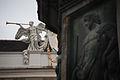 Imperial Palace exterior- angel trumpeter sculpture, fragment. Vienna, Austria, Western Europe.jpg