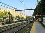 Inbound train at Woodland station, September 2015.JPG
