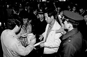 South Korean identity card - The implementation of social security was emblematic case showing that South Korea holds a total surveillance society. Past ID card checkpoints scene. Korea Times material photo.