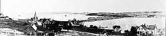 Iona, Nova Scotia - A view of Iona in the early 1900s. St.Columba Church to the left, the Grand Narrows Bridge over the Barra Strait in the background.
