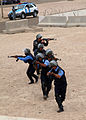 Iraqi police students approach a building while practicing clearing a building at the police academy in Basra, Iraq, April 20, 2011 110420-A-YD132-156.jpg