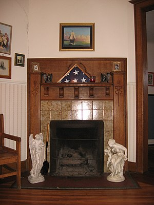 John L. Nichols House - Living room with fireplace