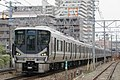 JRW Series 225-0 set I5 at Nakatani-daiichi railroad crossing.jpg