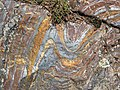 Jaspilite banded iron formation (Soudan Iron-Formation, Neoarchean, ~2.69 Ga; Stuntz Bay Road outcrop, Soudan Underground State Park, Soudan, Minnesota, USA) 2 (19198997276).jpg
