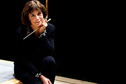 JoAnn Falletta sitting on stage with baton by Cheryl Gorski Photography.jpg