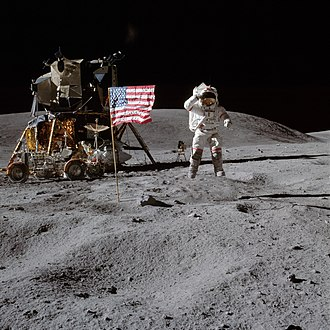 Apollo 16 - John Young on the Moon, with the Apollo Lunar Module and Lunar Roving Vehicle in the background