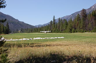 Johnson Creek Airport - A Maule M-6 landing on runway 17