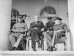 Joseph Stalin, Franklin D Roosevelt and Winston Churchill on the veranda of the Soviet Legation in Teheran, during the first 'Big Three' Conference, November 1943. A20710.jpg