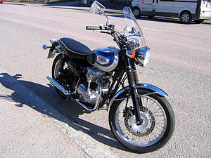 "Kawasaki W650 - The right side of the motorcycle reveals the Ducati Desmo style cover for the bevel drive system that operates the camshaft.The color scheme is called ""Galaxy Silver/Luminous Boralis Blue"" (2000)."