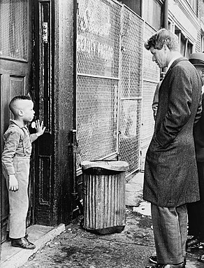 Kennedy discusses school with young Ricky Taggart.jpg