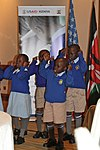 Kenyan Students First grade students from Langata West Primary School in Nairobi County perform a poem (9737041642).jpg