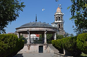 Zacoalco de Torres - Kiosk in the town square with the tower of the San Francisco Parish visible