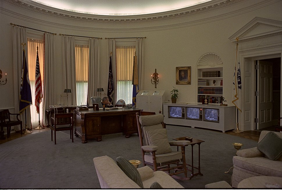 LBJ watching TV in the Oval Office.jpg