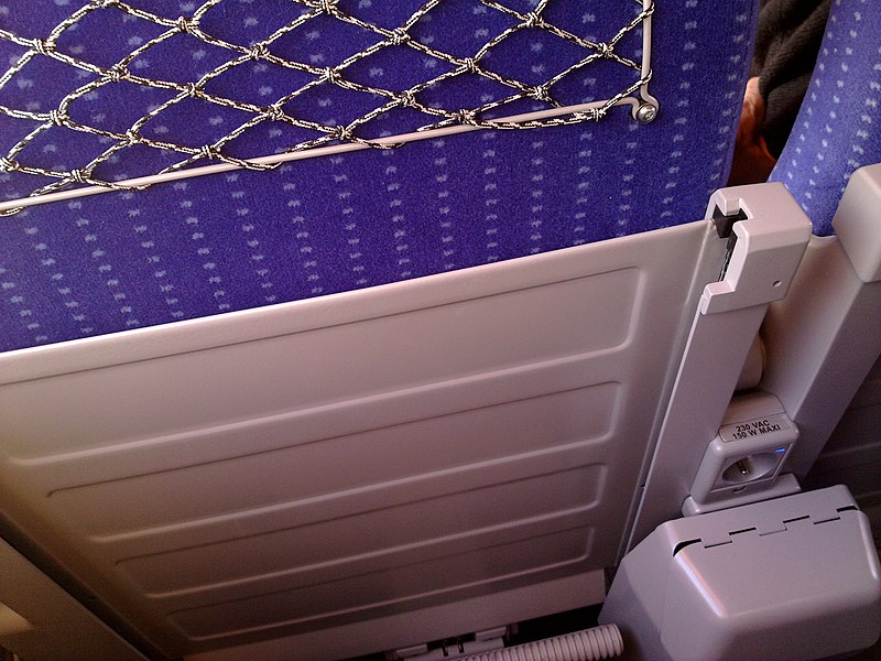 Detail of a seat equipped with an electric outlet in 2nd class higher room of the TGV Euroduplex (2N2) number 4703 train running between Belfort - Montbéliard TGV and Besançon Franche-Comté TGV railway stations on the day of these two stations' inaugural.