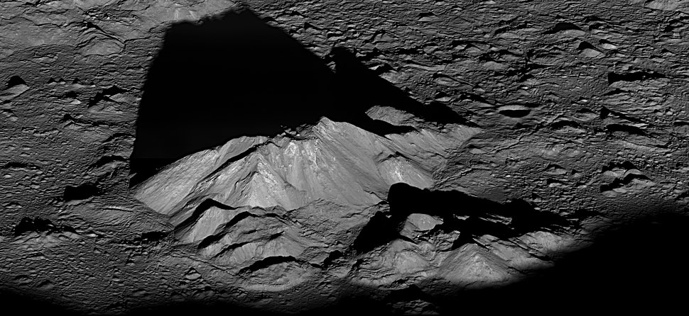 Tycho crater's central peak complex casts a long, dark shadow near local sunrise.