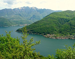 Brusino Arsizio - Lake Lugano seen from above Morcote. In the middle: the village of Brusino Arsizio and the Monte San Giorgio. In the background: Monte Generoso