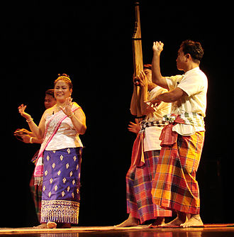 Dance and theatre of Laos - A khene player and Lao dancers at a morlam performance in France.