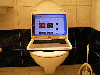A notebook over a toilet.