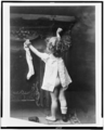 Little girl hanging up stocking by fireplace, retouched.png