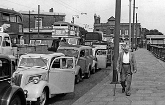 Woolwich Ferry - Traffic queueing for the Woolwich Ferry in 1955. The conversion to a Roll On Roll Off vehicle service in 1963 reduced waiting times.