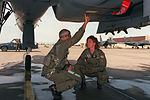 Lt. Col. John R Sheekley discusses the flare module below the right side intake with 1st Lt. Jeannie Flynn during the preflight inspection F-3530-SCN-95-000016-xx-0037.jpg
