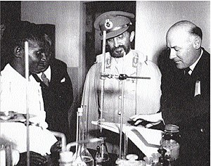 Addis Ababa University - Emperor Haile Selassie (center) and French Canadian Jesuit, Fr. Lucien Matte, SJ (right) at the University, 1951