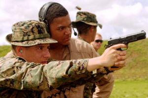 MEU(SOC) pistol - A Marine fires the MEU(SOC) pistol