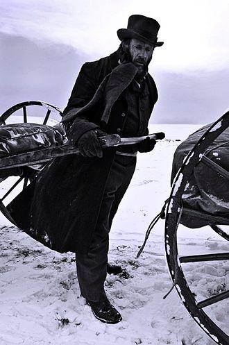 Mormon handcart pioneers - Dramatization of man pulling handcart through snow