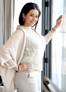 A photograph of Koirala smiling at the camera during promotions for her film Bhoot Returns