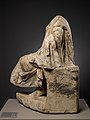 Marble statue of a draped seated man MET DP338135.jpg