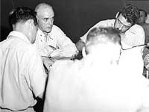 Charles B. McVay III - McVay talks to war correspondents in Guam about the sinking of his ship in August 1945