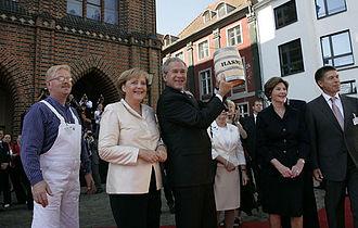 Joachim Sauer - Sauer (right) with Angela Merkel, George W. Bush and Laura Bush