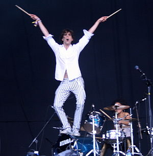 Struts his stuff on top of the drum kit all ni...