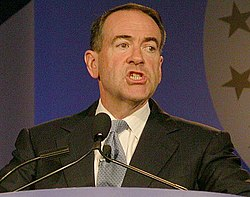Huckabee speaking at a lectern