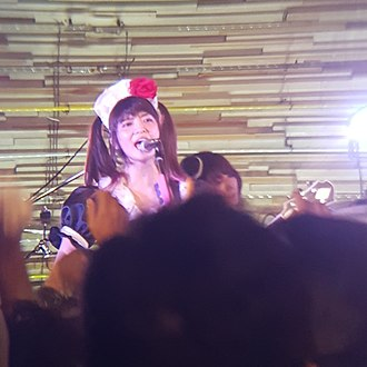 Band-Maid - Miku Kobato and Akane Hirose (back) performing in 2017.