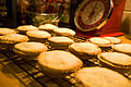 Mince pies on wire rack with clock in background.jpg