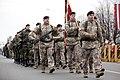 Ministru prezidents Valdis Dombrovskis vēro Nacionālo bruņoto spēku vienību militāro parādi 11.novembra krastmalā (6357911061).jpg