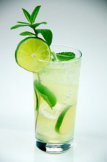 Mojito made with rum, lime, sugar, mint, club soda, served in a tall glass - Evan Swigart.jpg