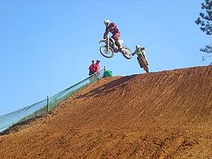 Motocross - A motocross rider coming off a jump.