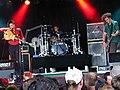 Muse at Roskilde Festival 2000 (4688870098).jpg