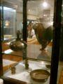 Museo archeologico di artimino, coppe e utensili in bronzo per il rito del vino.JPG