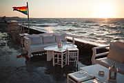 Mykonos island quay. Sunset over Agean Sea. Cyclades, Greece.jpg