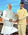 Narendra Modi being presented a memento by the Chief Minister of Andhra Pradesh, Shri N. Chandrababu Naidu, at the foundation stone laying ceremony of 'Amaravathi'- the new capital city of Andhra Pradesh on October 22, 2015.jpg