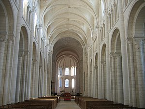 Nave - The Romanesque nave of the abbey church of Saint-Georges-de-Boscherville, Normandy, France, has a triforium passage above the aisle vaulting.